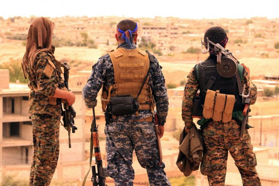 Des combattants desForces démocratiques syriennes.... (Photo archives Forces démocratiques syriennes via AP)