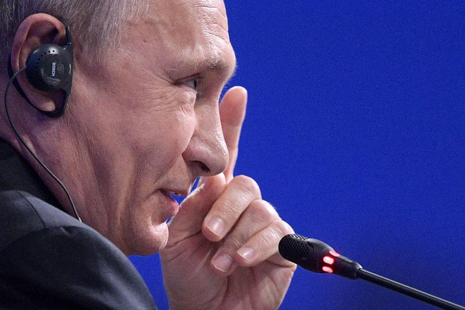 Le président russe Vladimir Poutine a accordé une... (PHOTO Alexey DRUZHININ, AFP/SPUTNIK)