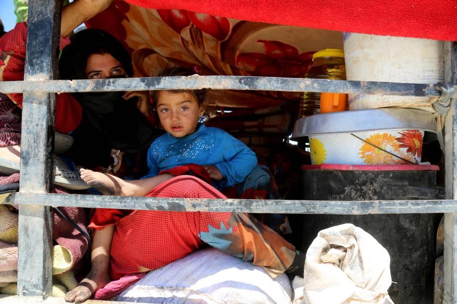 Près de Raqqa, des Syriens rêvent de fêter la fin du ramadan dans... (PHOTO AFP)