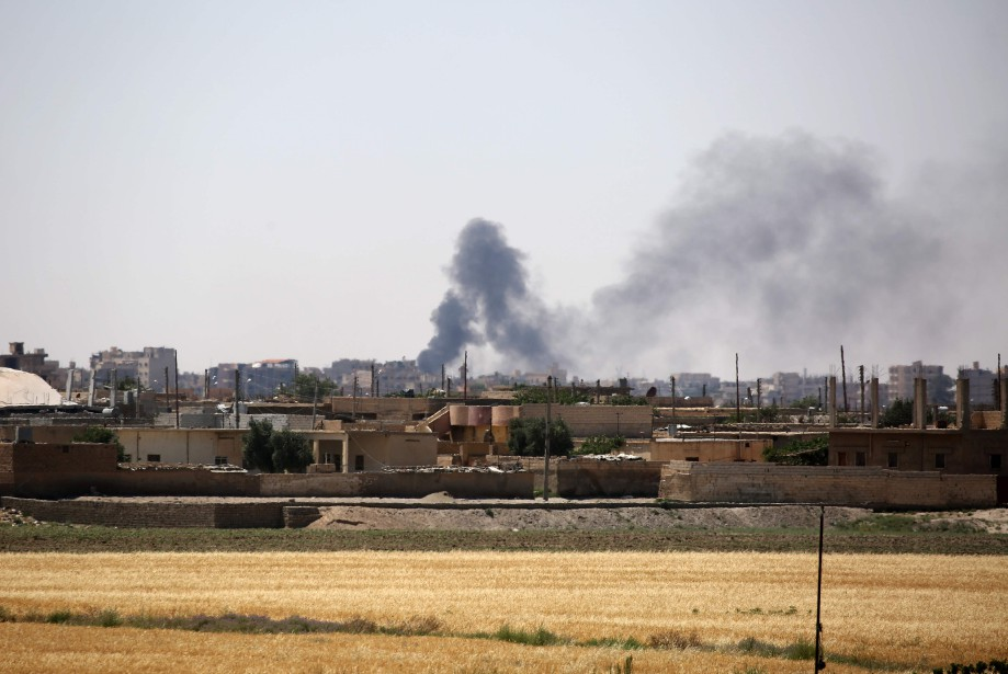 Des forces arabo-kurdes... (Photo Delil Souleiman, Agence France-Presse)