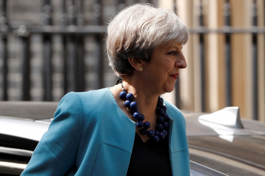 Theresa May... (Photo Stefan Wermuth, REUTERS)