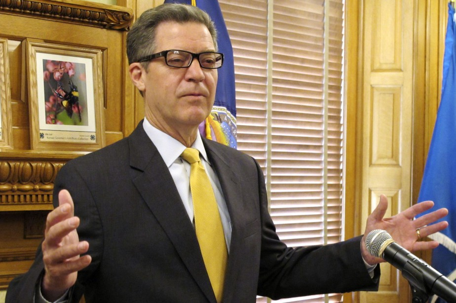 Le gouverneur du Kansas, Sam Brownback.... (PHOTO AP)