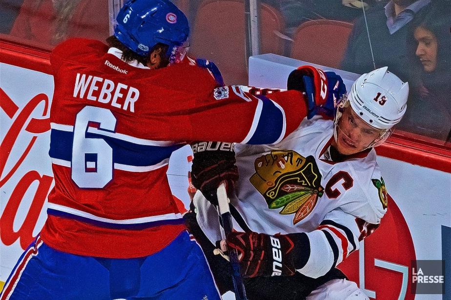 Shea Weber et Jonathan Toews... (Photo André Pichette, archives La Presse)