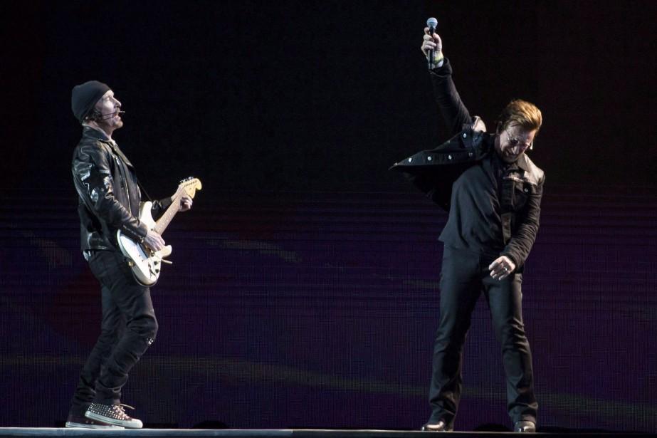 Bono et the Edge lors de l'ouverture de... (Photo Jonathan Hayward, archives La Presse canadienne)