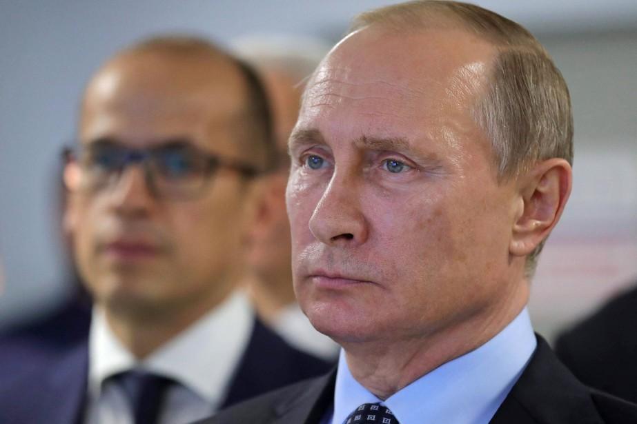 Le président russe Vladimir Poutine... (PHOTO Mikhail Klimentyev, AP)