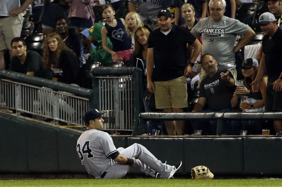 Dexter Fowler a calmement tenté de se lever... (Photo Nam Y. Huh, Associated Press)