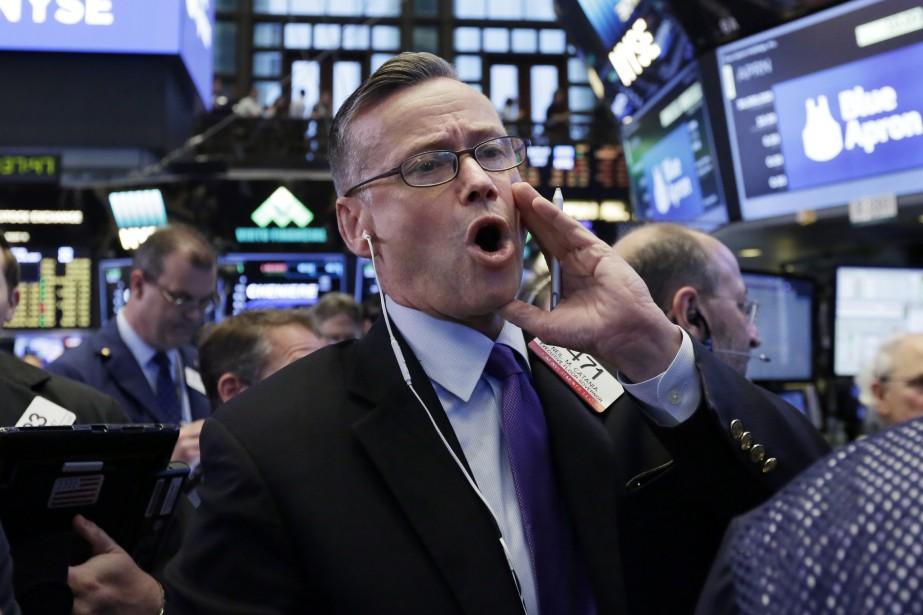 Vers 9h40, l'indice vedette Dow Jones Industrial Average... (Photo Richard Drew, Associated Press)