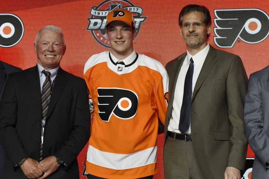 Le directeur général des Flyers, Ron Hextall(à droite),... (David Banks, USA TODAY Sports)