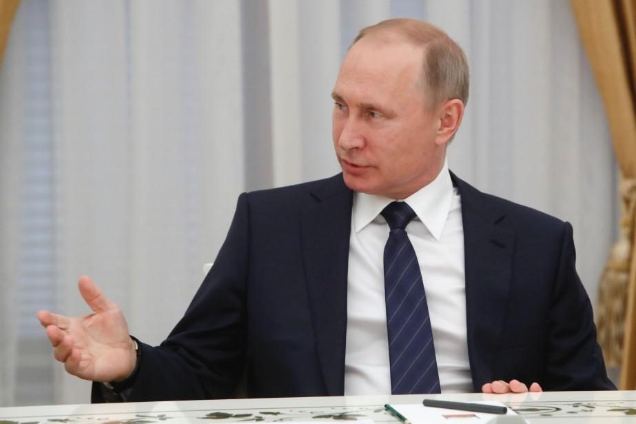 Le président russe Vladimir Poutine... (PHOTO Sergei Karpukhin, ARCHIVES AFP)