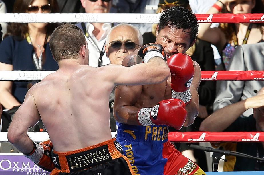 Jeff Horn assène une droite à Manny Pacquiao.... (PHOTO TERTIUS PICKARD, ASSOCIATED PRESS)