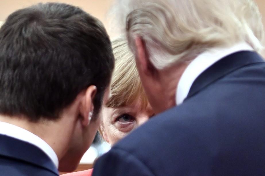 Le président français Emmanuel Macron, la chancelière Angela... (Photo John MacDougall, AP)