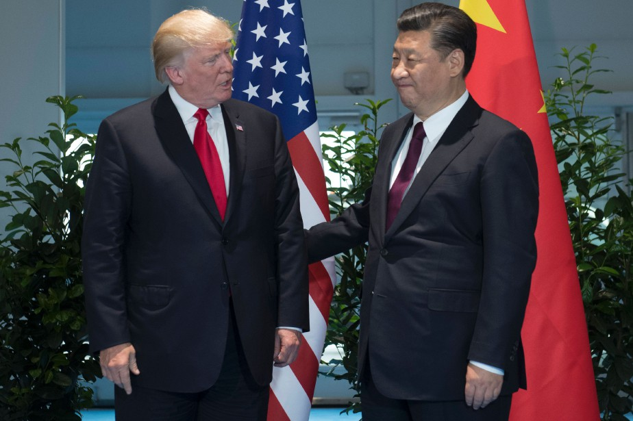 Donald Trump et son homologue chinois Xi Jinping... (PHOTO SAUL LOEB, AFP)