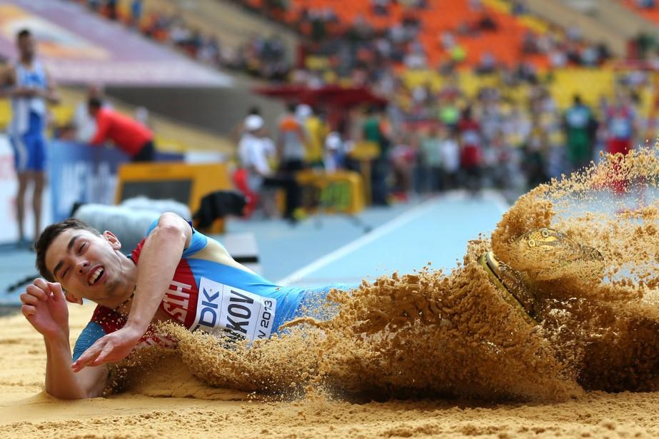 Le Russe Alexandr Menkov estchampion du monde 2013... (Photo ADRIAN DENNIS, archives AFP)