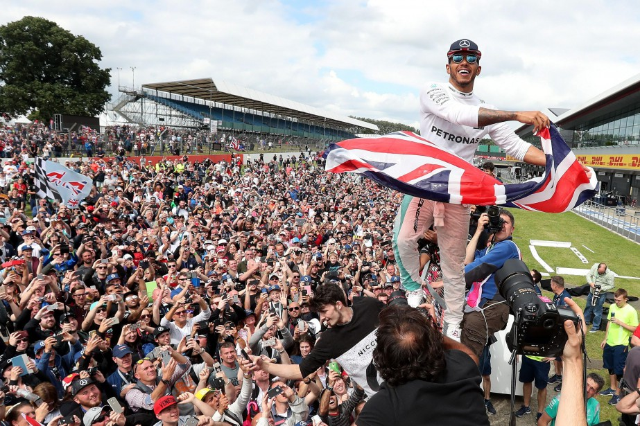 Mercedes driver Lewis Hamilton of Britain celebrates after...