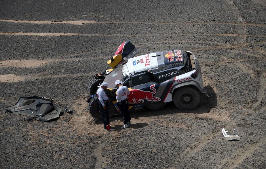 Les Français Sébastien Loeb et Daniel Éléna ont perdu tout espoir de gagner le rallye Silk Way après leur accident de lundi. (AFP)