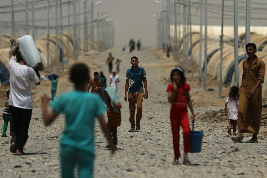 Dans ce centre qui accueille 18 000 personnes... (AFP)