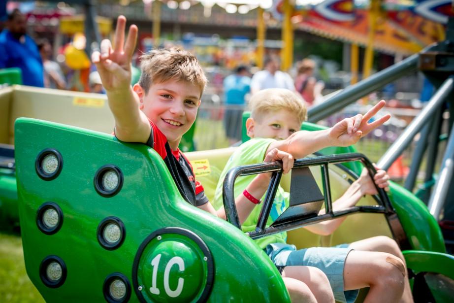 Les enfants s'amusent toujours beaucoup dans les manèges de la Fête du lac. (Spectre Média, André Vuillemin)