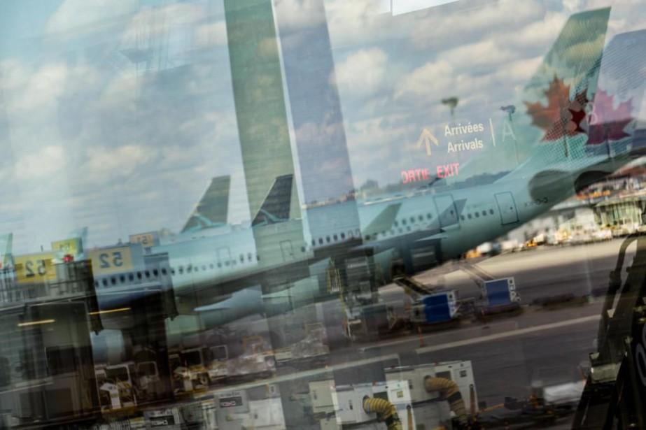 L'ascension d'Air Canada... (PHOTO EDOUARD PLANTE-FRÉCHETTE, ARCHIVES LA PRESSE)