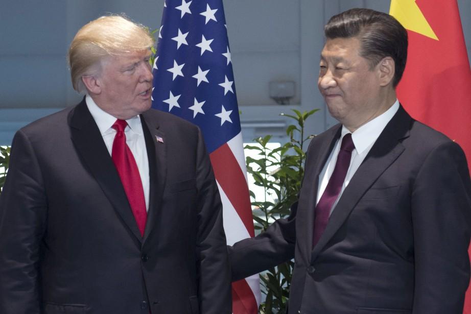 Le président américain Donald Trump et son homologue... (Photo Saul Loeb, AP)