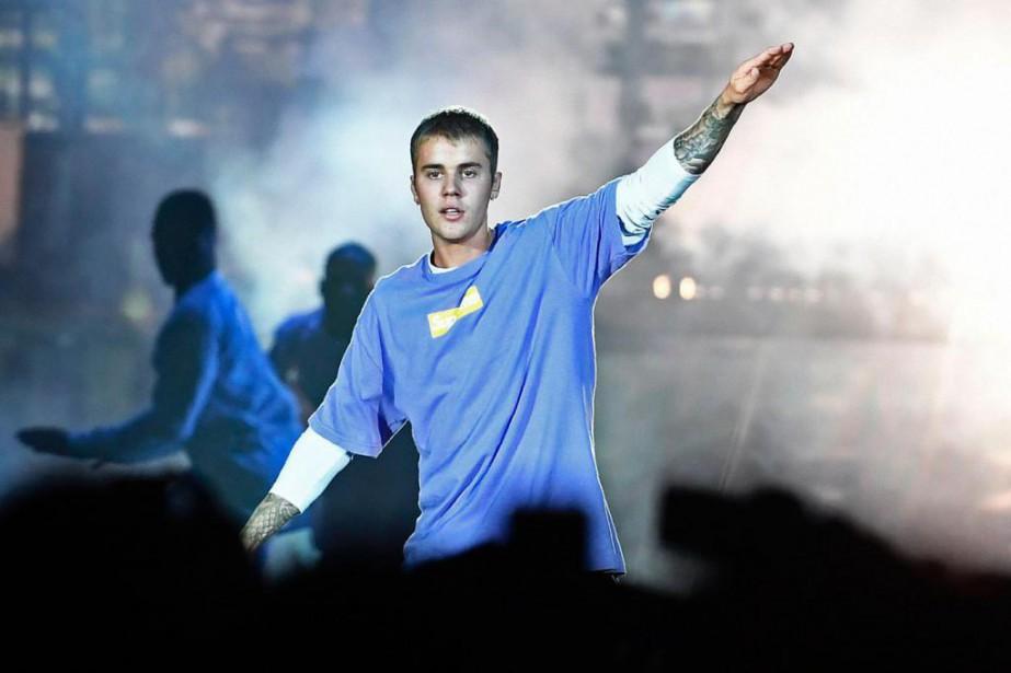 Le chanteur canadien Justin Bieber... (PhotoCHRISTOPHE ARCHAMBAULT, Agence France-Presse)