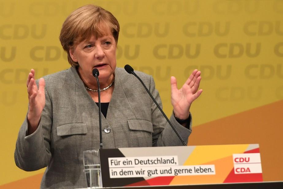 La chancelière allemande Angela Merkel a prononcé un... (PHOTO PATRIK STOLLARZ, AFP)