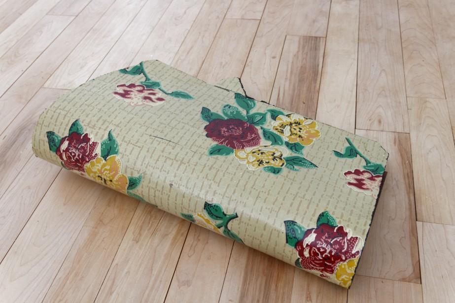 Un prélart couvrait le plancher de bois d'origine. La propriétaire a retiré le vieux revêtement et restauré le plancher de bois. (Mélissa Bradette)