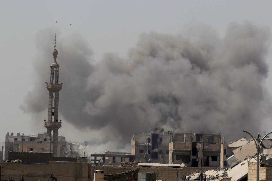 Lundi, 42 civils, dont 19 enfants et 12... (REUTERS)