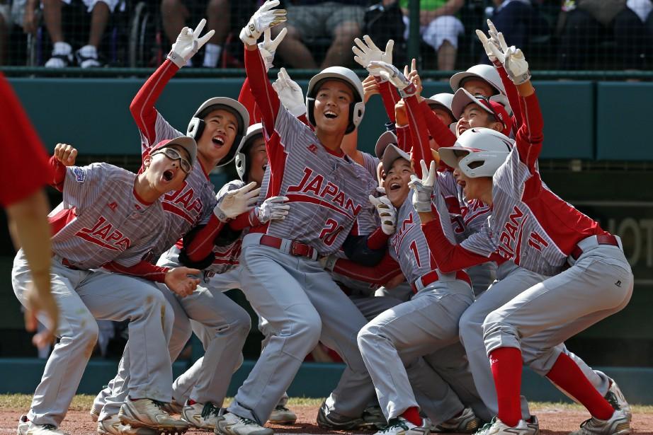 Victoire facile de l'équipe japonaise sur le Canada.... (Photo Gene J. Puskar, AP)