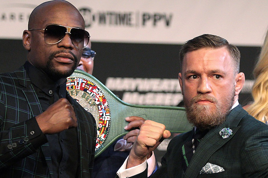 Floyd Mayweather Jr. (L) et Connor Mcgregor tenteront... (PHOTO JOHN GURZINSKI, AGENCE FRANCE-PRESSE)