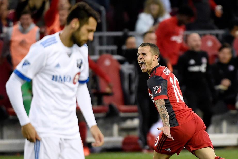 Sebastian Giovinco célèbre son but marqué dans les... (PHOTO NATHAN DENETTE, ARCHIVES LA PRESSE CANADIENNE)