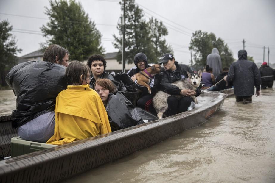 Après cinq jours consécutifs de précipitations, la tempête... (Photo The New York Times)