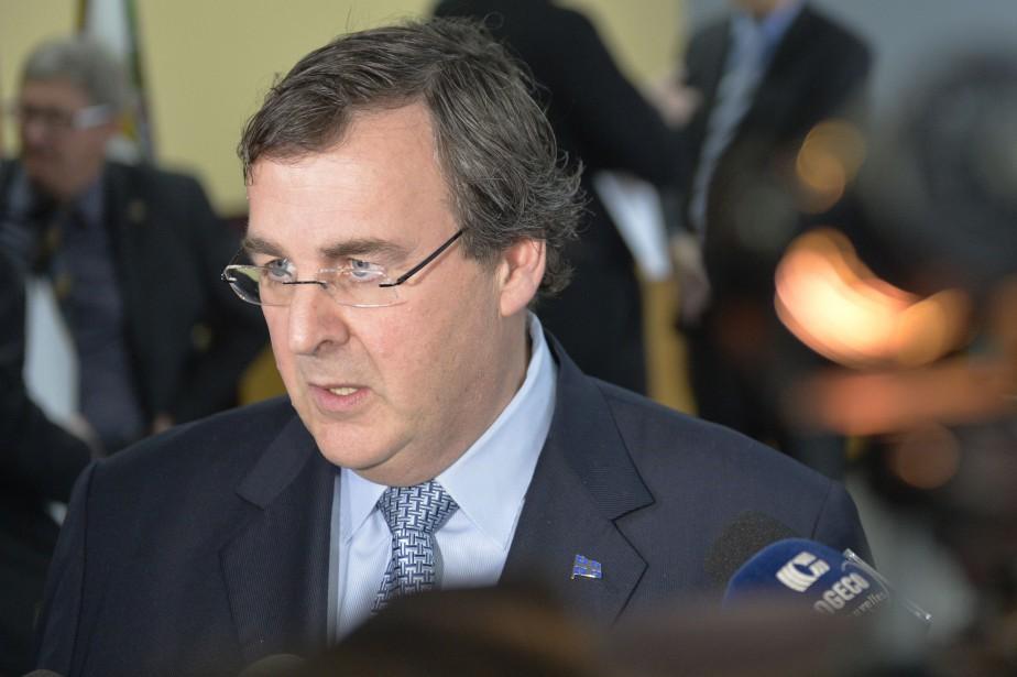 Le ministre de l'Emploi et de la Solidarité... (PHOTO LE SOLEIL)