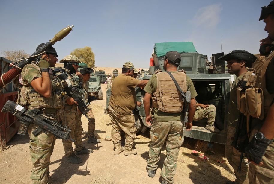 Formés par des armées étrangères, dont américaine et... (AFP)