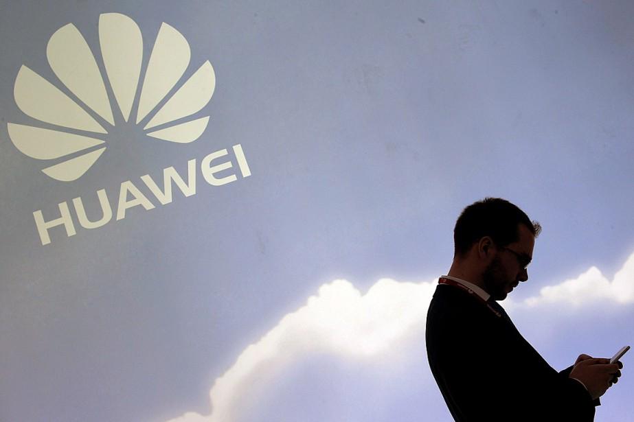 Au-delà du nuage, Huawei ambitionne de porter à... (PHOTO LLUIS GENE, ARCHIVES AGENCE FRANCE-PRESSE)