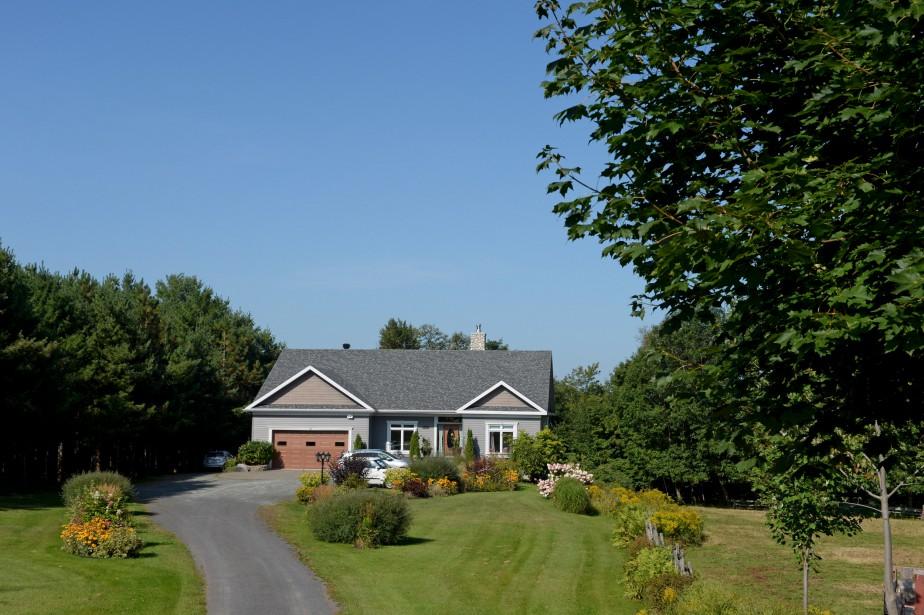 Pour dessiner sa demeure, la propriétaire s'est inspirée de l'architecture des maisons du Maine. (Le Soleil, Pascal Ratthé)