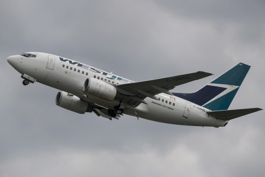 WestJet est en route pour les îles Turks-et-Caïcos... (Photo Christopher Katsarov, archives PC)