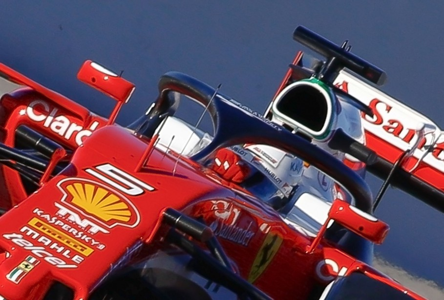 Ferrari's German driver Sebastian Vettel drives a car...