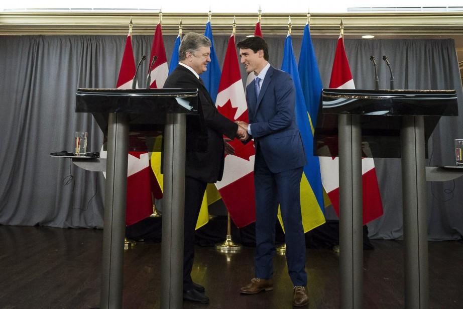 Cette mesure, annoncée lors de la rencontre entre... (PHOTO Christopher Katsarov, LA PRESSE CANADIENNE)