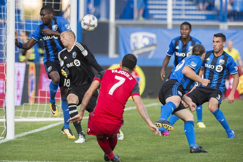 Avec quatre matchs à jouer, l'Impact est à... (Photo Graham Hughes, archives PC)