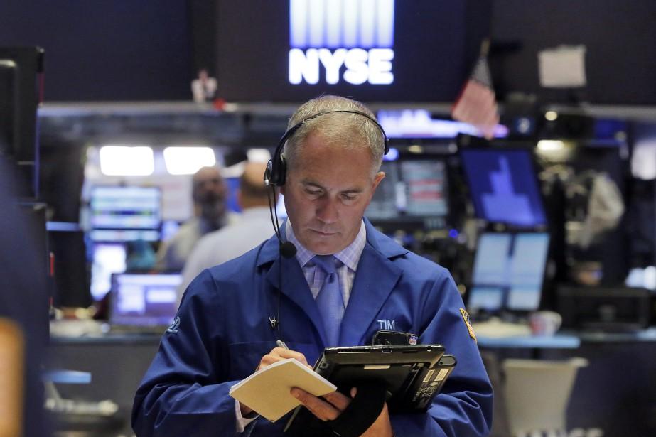 Le marché poursuivait sa hausse après cinq clôtures... (AP)