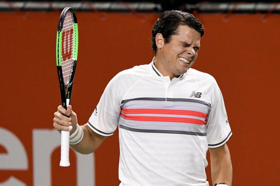Milos Raonica abandonné en raison d'une blessure au... (Photo Toru Yamanaka, AFP)