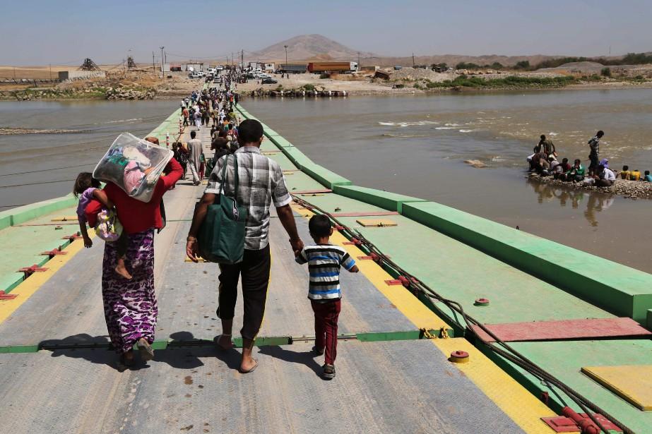 Des milliers de femmes et adolescentes, en particulier... (PHOTO Khalid Mohammed, ARCHIVES AP)