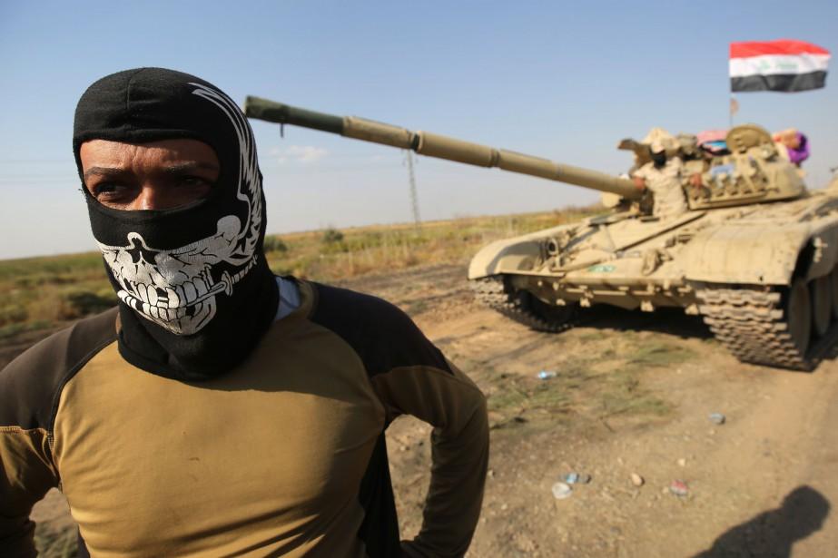 Les troupes irakiennes entendent «sécuriser les bases et... (PHOTO AFP)