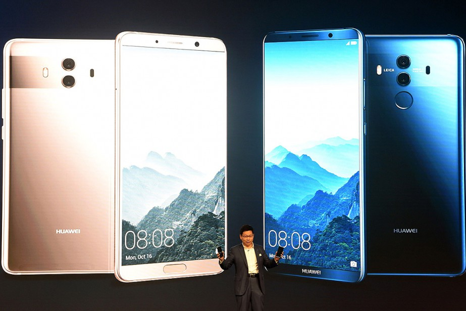 Le patron du géant chinois des télécoms Huawei,... (PHOTO CHRISTOF STACHE, AGENCE FRANCE-PRESSE)