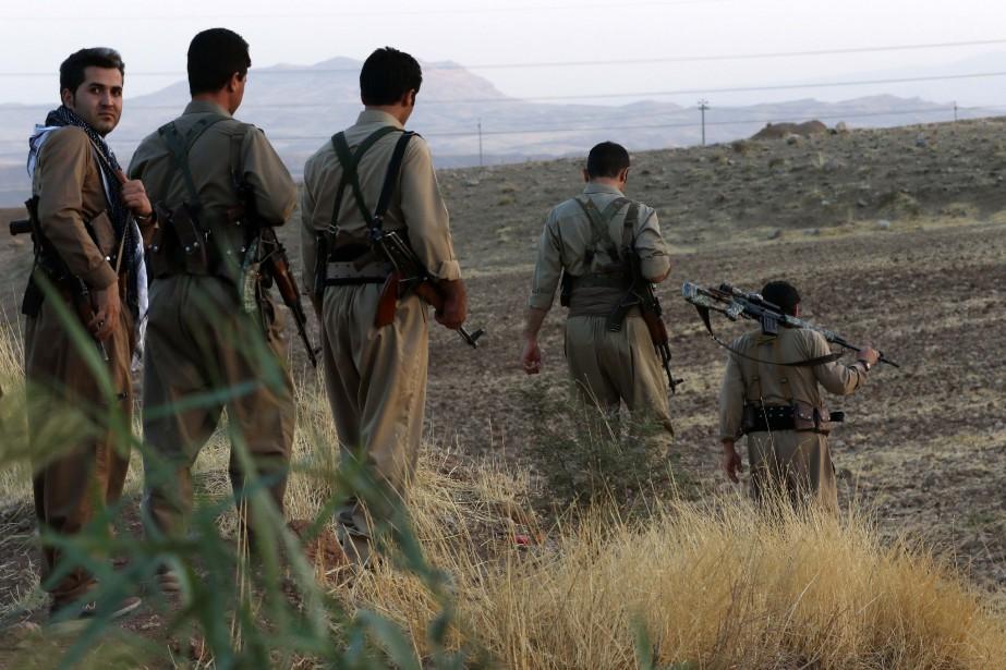 Des soldats kurdes particpent à un entraînement militaire... (AFP)