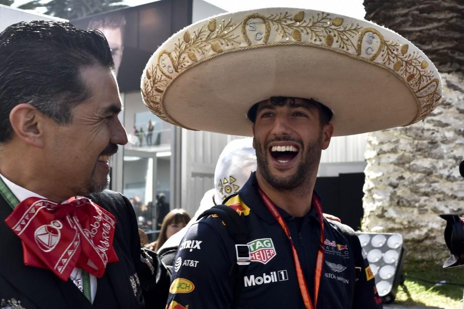 L'Australien Daniel Ricciardo (à d.) est arrivé au... (photo : AFP)