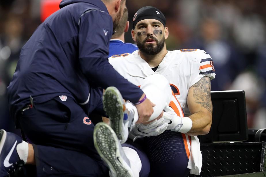 Zach Millera dû être transporté hors du terrain... (Photo AFP)