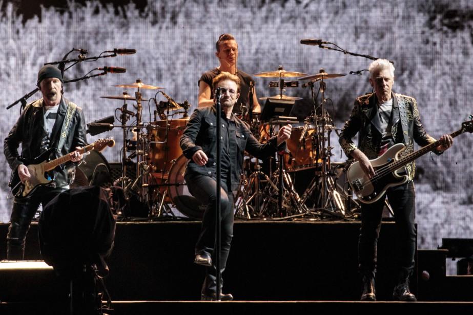 Le mythique groupe de rock U2 a dévoilé mercredi des... (PHOTO ARCHIVES AFP)