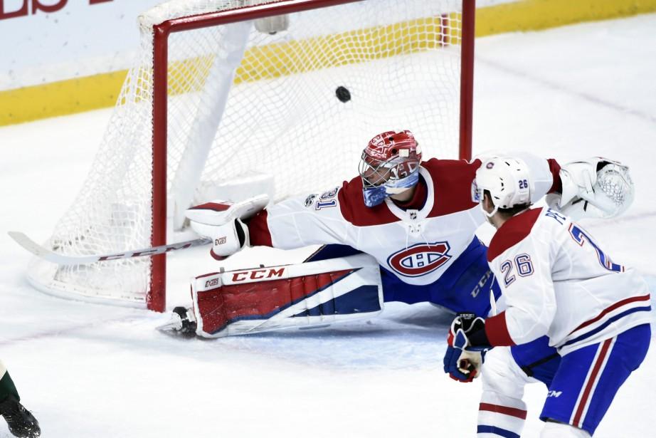 Le gardien du Canadien Carey Price se fait déjouer par un Tyler Ennis lors du premier tiers. (PHOTO Hannah Foslien, AP)