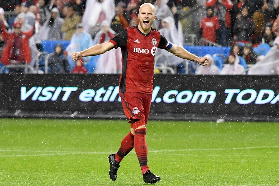 Michael Bradley célèbre la qualification du TorontoFC àla... (PHOTO DAN HAMILTON, USA TODAY)